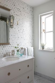 Sarah Richardson London Flat Guest Bathroom All this gray tile is so pretty with carrera marble!