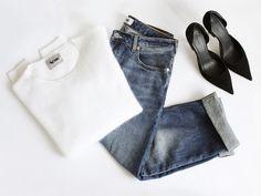 Blue jeans, white shirt, black heels.
