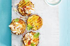 Grilled Pineapple With Rum Caramel Sauce—One of the juiciest of fruits, sweet-and-sour pineapple stars in this summer-ready dessert that, topped with a rum-infused caramel sauce, will transport you to the tropics.