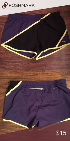 """Nike Dry Fit Running Shorts Nike running short. Never worn. Measures 10 3/4"""" from top to bottom. Zipper in the back. Dry Fit. Purple yellow and black Nike Shorts"""