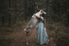 "girl with reindeer. Katerina Plotnikova is a fine art.jpg photographer from Russia who explains her work as ""another tale about wonderland."""
