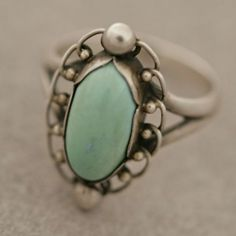 Georg Jensen. Design no. 24. Ring. Silver and turquoise. Stone setting with 6 scalloped edges. View 1.