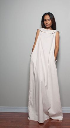 A stunning white linen maxi dress with an attached hood.