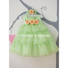 Infant Dress With Tiered Organza Layers:  Three layers of soft chiffon layers on organza dress with crinloine underneath to create extra fullness. Satin bodice is accented with roses . Head band with bow and matching flower is included.