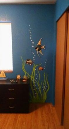 Just finished painting grasses and bubbles around plastic fish for the kids under the ocean bedroom. Ocean Bedroom Kids, Ocean Room, Sea Murals, Ocean Mural, Sea Bedrooms, Underwater Room, Kids Room Murals, Murals For Kids, Mermaid Bedroom