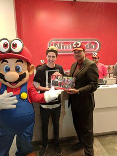 First copy of Mario Odyssey sold at Nintendo NYC by Reggie!