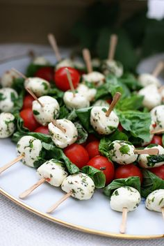 Caprese Skewers. On skewer alternate fresh mozzarella balls, cherry tomatoes and basil. Drizzle (very lightly) with good olive oil then sprinkl with salt, pepper and a bit of chopped basil.