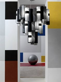 Time to workout for our LA LOLLO #Mackintosh, shot by photography master Massimo Listri in a private gymnasium. Over the Technogym wellness ball, this chandelier fits perfectly within the Mondrian-colored room thanks to its geometric pattern, which pays homage to the #artnouveau's architect Charles Rennie Mackintosh.  Discover more at www.slamp.com