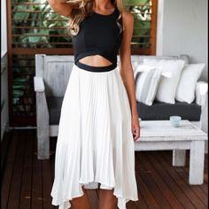 Color Block Asymmetrical White Black Dress Super cute asymmetrical cut out dress. Size medium. Brand new never worn. Dresses