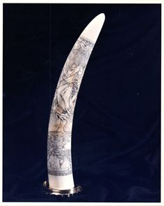 Scrimshawed Elephant tusk. By David Pudelwitts-St. Albans. 1989. St. Michael Battling the Dragon by Albrecht Durer. Right view.