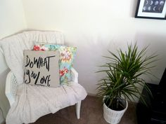 An old chair from the thrift store, painted white and covered with a blanket. Easy way to add seating to your living room! Cushion covers from H&M home.