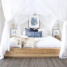 Coastal bedroom with coral wall art