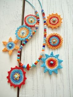 This Pin was discovered by Şer Crochet Lanyard, Crochet Bracelet, Crochet Earrings, Thread Jewellery, Textile Jewelry, Fabric Jewelry, Crochet Mandala Pattern, Crochet Circles, Necklaces