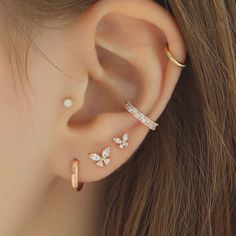 Butterfly Cartilage Piercings! Available in silver, gold and rose gold! #cartilagepiercing #earpiercings #curatedear #earstack #cartilageearrings #butterflypiercing #cartilage #earcandy #butterflycartilage Different Ear Piercings, Pretty Ear Piercings, Ear Peircings, Multiple Ear Piercings, Tragus Piercings, Cartilage Earrings, Stud Earrings, Piercings For Small Ears, Auricle Piercing