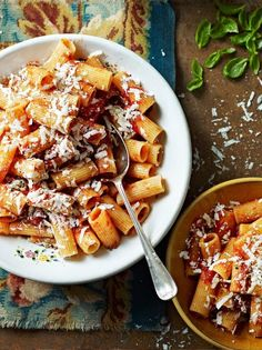 Rigatoni with roasted tomatoes and ricotta salata in a rich tomato sauce. This tomato sauce is cooked twice – once in the oven and once on the hob – for the best rich sauce that clings to the rigatoni Rigatoni, Jamie Oliver Pasta, Jaime Oliver, Pasta Recipes, Cooking Recipes, Risotto Recipes, Vegetarian Spaghetti, Pasta Nutrition, Vegetarian Recipes