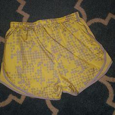 Nike Dri-Fit athletic shorts Barely worn yellow athletic shorts with grey polka dots Nike Shorts