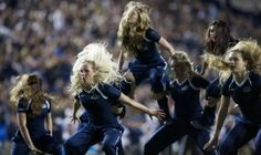 The Cougarettes perform their hip hop routine during the BYU vs. UConn game. The…