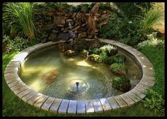 Best  Feng Shui Garten creative family project in Belgrade ying yang pond with vegetation and stone boulder