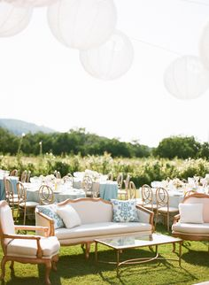 Lanterns and vintage furnishings in a fun lounge. Archive Vintage Rentals + Classic Party Rentals.