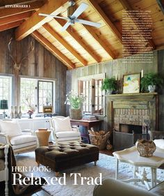 comfortable rustic living room. don't think I could ever get away with white chairs with my kids though :)