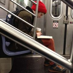 Cera reads, has coffee. Tip of the hat to tumblr societyisnotmygod for the lead on this. heart-augmented:  Michael Cera calmly reading on the train
