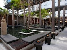 "I would like my swimming pool partially covered like this. ""This award-winning hotel blends Asian Zen principles with a decidedly modern aesthetic. Lead designer and architect Jean-Michel Gathy created this peaceful outdoor water garden where guests can sit quietly at one with nature or enjoy sophisticated nibbles in sunken dining areas. Image courtesy of Oyster.com"""