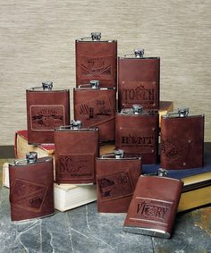 H2O (Hip to Own) Stainless Flask  Hip flasks wrapped in luscious brown leather are an ideal gift for the man in your life. Choose from an assortment of designer personality patches for a gift that will truly reflect his style. Each flask holds 6 fluid oz.