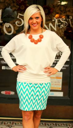 "Emerald Green Chevron ""Metro"" Skirt.  S, M, L, XL.  $19.99.  ""Teagan"" Top shown in White.  S, M, L.  $29.99.  Available at 105 West Boutique in Abbeville, SC.  (864) 366-WEST.  Shipping $5."