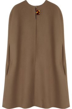 It's all about the cape.  This Lanvin number will only set you back $3400 or so bucks.                                                                                                                                                                                 More