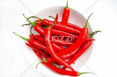 Peppers in a Bowl - Bright red chilli peppers in a white bowl