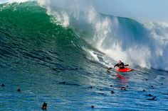 """Kayak Surfing Nelscott Reef, Oregon  Photograph by Richard Hallman    """"There is something about knowing a mistake can have pretty severe consequences that makes moments like these feel extra special,"""" says champion extreme kayaker Tao Berman, who waited four years before all the pieces fell together to kayak surf this monster wave at Nelscott Reef, located about a half mile offshore in Oregon."""