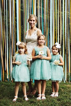 bride with her flower girls in teal // photo by Sarah Culver