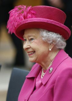 """Queen Elizabeth visits the National Theatre to commemorate the institution's 50th anniversary on October 22, 2013 in London, England. / featured in """"Queen Elizabeth's #Hats on Parade"""" at AuthorAngelaBell.com"""