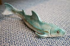 Made in France by a husband and wife team, all of their work is inspired by the Japanese art of Raku, which finds beauty in the imperfections and visible human touch. This gorgeous handmade fish is over a foot long!