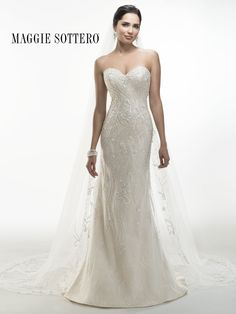 Maggie Sottero - DONNA, Glimmering heavily beaded embroidery, accented with sparkling Swarovski crystals, cascades over Chantilly lace in this sheath dress. Crystal buttons adorn a zipper back over inner corset closure.