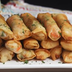 Cooking for a crowd and need the perfect appetizer? Try making these shrimp and veggie-stuffed lumpia, or, as they're referred to in the Philippines, lumpia togue-- togue meaning bean sprout Shrimp Spring Rolls, Chicken Spring Rolls, Vegetable Spring Rolls, Shrimp Egg Rolls, Vegetable Egg Rolls, Fried Spring Rolls, Seafood Dishes, Seafood Recipes, Appetizer Recipes