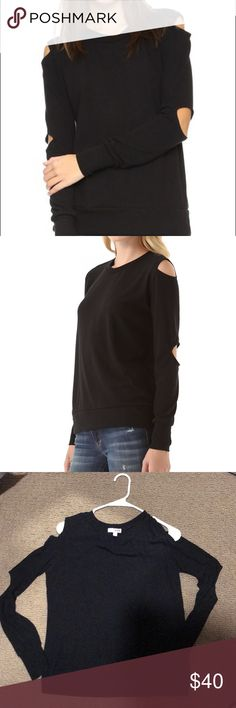 LNA Cutout Black Sweater Shoulder and elbow cutouts split the long sleeves of this fine-knit sweater, giving a modern point of view to a cool-weather classic.  Fabric: Fine knit. 47% polyester/47% rayon/6% spandex. Hand wash. Made in the USA.  Pre-owned: Likely New LNA Sweaters Crew & Scoop Necks