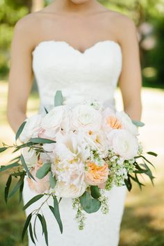 Bouquet with creams, whites, blushes, and peaches. Ranunculus, Juliet garden roses, peonies, white lilac, eucalyptus leaves, O'Hara garden roses, hydrangeas, and snapdragons. | Tucker Images - Southern Weddings Magazine. View More: http://tuckerimages.pass.us/loganandhayden