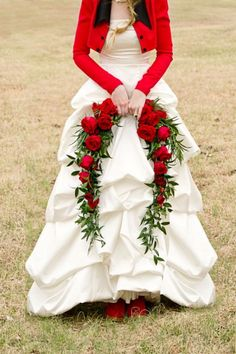 I think this is beautiful... let's perk up the old white wedding dress with a bright red Spencer...   and the roses aren't bad either, though I'm not sure about the funereal spray...
