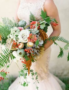 woodland bouquet: poppy pod, ferns, ivy, mushrooms, pepperberries, roses | bride in mermaid ivory dress with lace and beaded