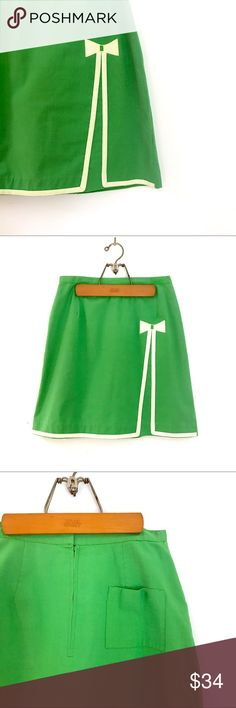70's Vintage Leon Levy High Waisted Q-Skirt Skort 70's Vintage Q-Skirt by Leon Levy. High waisted midi skort is lined with built in shorts! Color is vibrant green embellished w/ retro light yellow bow. Tag doesn't have fabric content but my guess would be cotton. Nice wove texture. One pocket and invisible zipper & large hook closure on the back along w/ a small slit. Excellent condition! Slight sporadic piling but works well w/ the vintage look. No size tag, measurements are a M/L. Skirt…