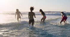 Group of friends swimming in the sea at sunset running into water getting wet and making splashes RED DRAGON - stock video clip Group Of Friends, Instagram Images, Instagram Posts, Getting Wet, Stock Video, Stock Footage, Oakley, Swimming, Ocean