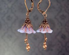 Beaded Jewelry Lavender Faerie Flower Earrings - Dainty light purple opalescent flower beads with leafy antiqued copper details. Perfect for channeling that inner woodland nymph or fairy. Artistic vintage inspired jewelry by Ardent Hearts Designs Wire Jewelry, Beaded Jewelry, Jewelery, Silver Jewelry, Silver Ring, Gold Jewellery, Indian Jewelry, Jewelry Findings, Jewelry Bracelets