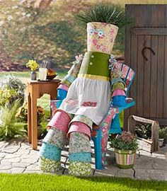 Rosie the Large Pot Lady made with Mod Podge fabric and clay pots