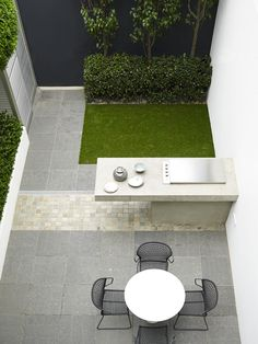 Keeping design to a bare minimum in this small courtyard gives it an openness and modern look.