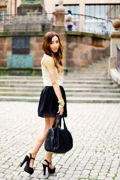 crochet and a black mini skirt   http://www.flirting-with-fashion.blogspot.com