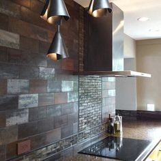 Copper and glass toned tile and three distinctive pendants updated this kitchen Dining Room Lighting, Kitchen Lighting, Beautiful Dining Rooms, How To Make Light, Mini Pendant, Backsplash, Wall Lights, Sink, Contemporary