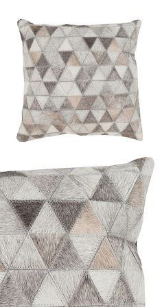 Meet your new favorite cuddle-up companion. Made with stitched hair-on-hide samples and a soft leather back, this Fiercely Throw Pillow is sure to make a cozy relaxing buddy. Covered with a fiercely st...  Find the Fiercely Throw Pillow, as seen in the Christmas in the City  Collection at http://dotandbo.com/collections/styleyourseason-christmas-in-the-city?utm_source=pinterest&utm_medium=organic&db_sku=114551
