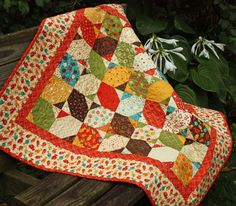 Fish, Polka Dots, Alphabets & Flowers adorn this cute Baby Quilt in Moda Lollipop Charm Fabric. $110.00, via Etsy.