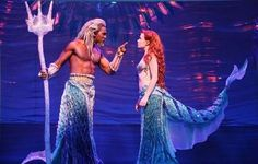 Ariel and King Triton from Disney's Broadway adaptation of The Little Mermaid. The costumes manage to allude to their animated counterparts without attempting to be exact recreations. The wire tails originally had motors to allow them to move independently of the actors.